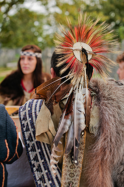 Image of Tim Turner in traditional Wampanoag garments and headdress